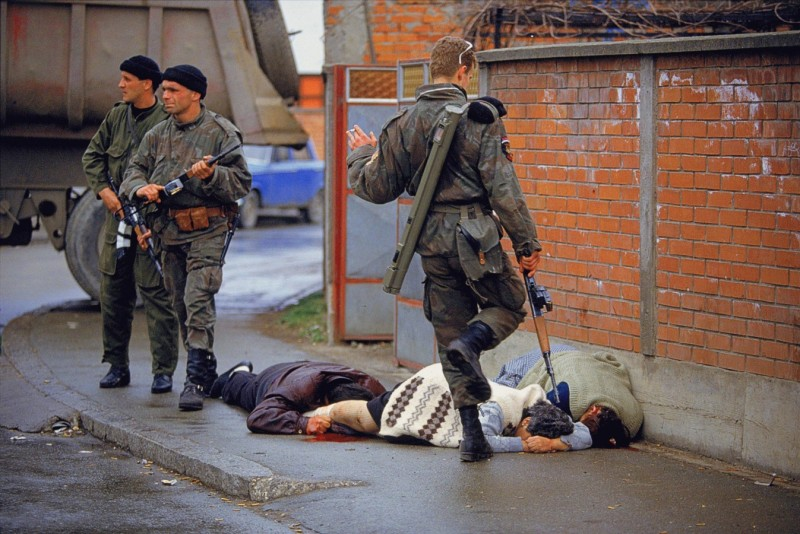 Serbian paramilitary group kick the dying bodies of the first Muslims to be killed in the war in Bosnia 1992_Photo Ron Haviv. jpg (2)_1