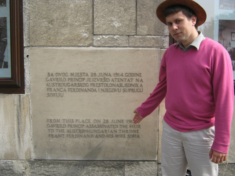 Me in front of the plaque marking the spot where the assassination of Archduke Franz Ferdinand took place
